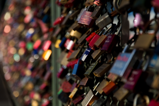 Love locks on a pedestrian and rail bridge in Köln crossing The River Rhine.